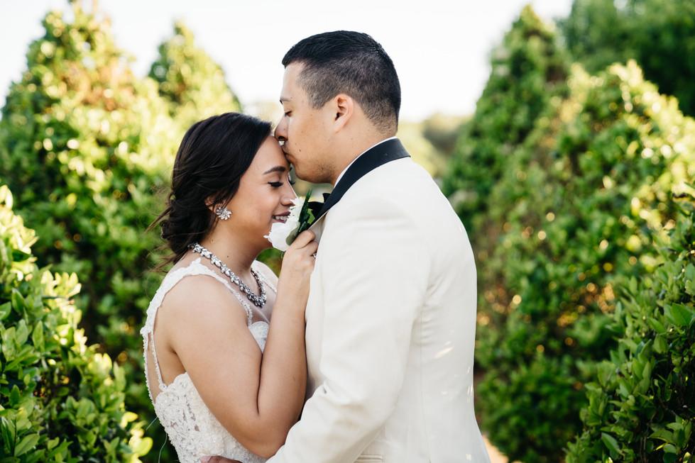 Groom Kissing Bride | Wedding Photography | Chromatone Studios