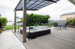 Cantilevered awning shades the spa