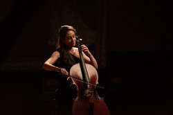 Aly head shot playing cello.jpg