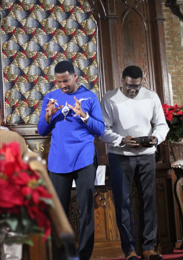 Deacon Gerald serving communion...