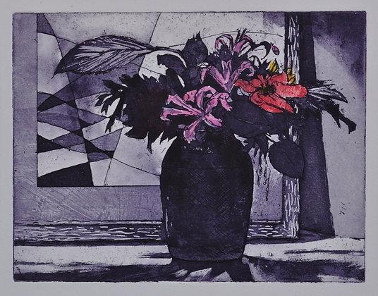 Nerines in a dark vase