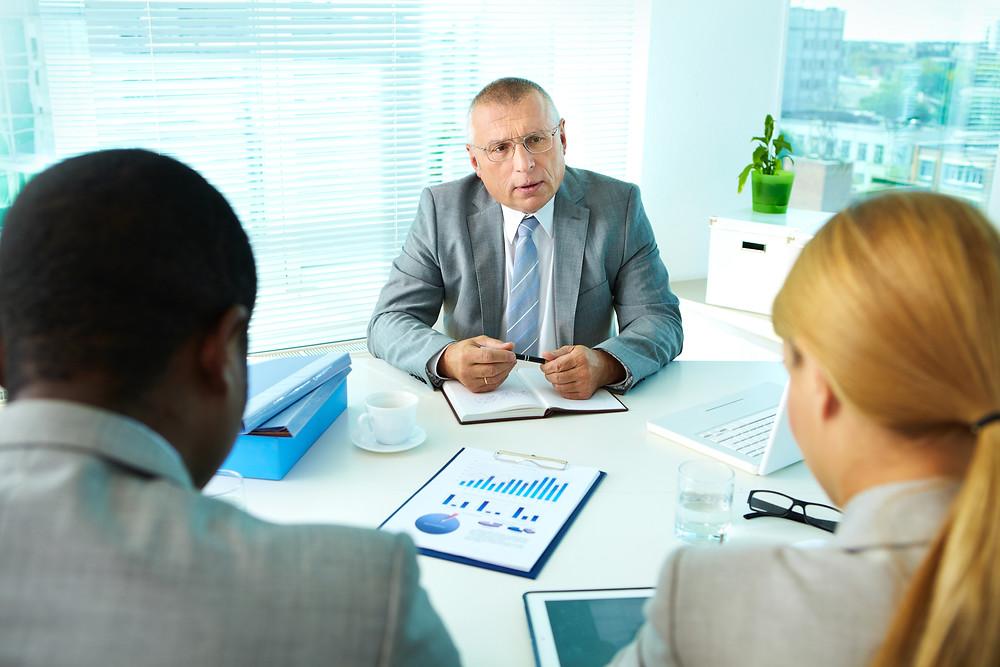 Boss speaks with millennial employees