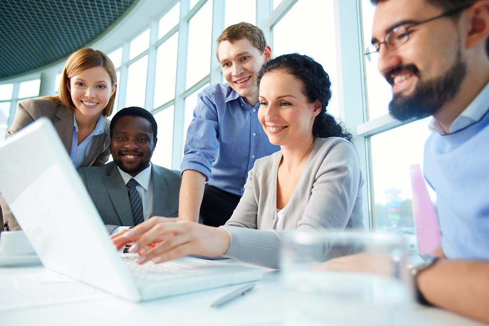 Diverse team members collaborating across generations
