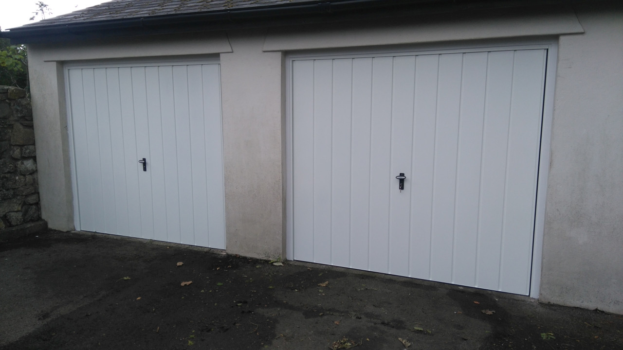 2matching pair of up and over doors in v