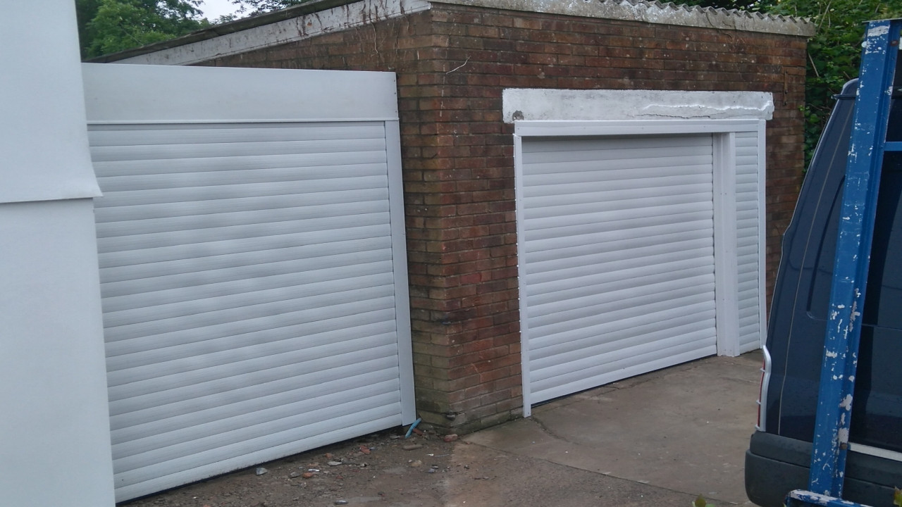 2pair of white insulated roller doors.jp