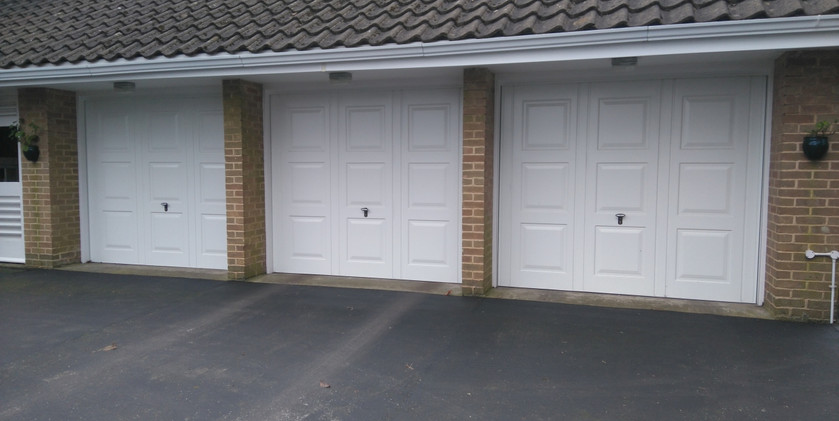 2matching triple up and over doors georg