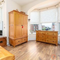 Laminate floored bedroom