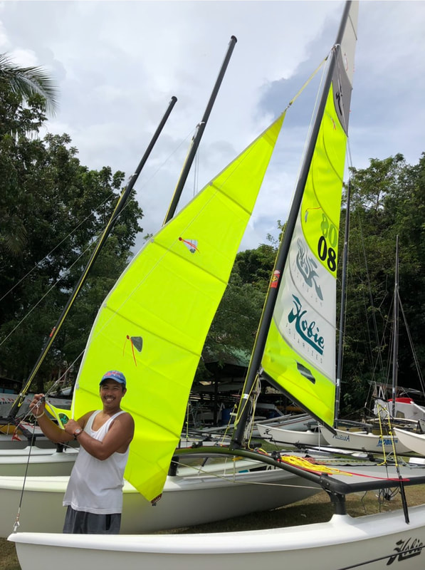 Boyette, the well-known boat fixer, assembles one of the new Hobie 16s