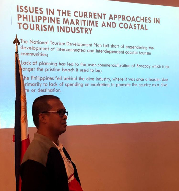 Mr. Jesse Pascasio, Director for Strategic Planning and Communications of National Coast Watch Council Secretariat discussing the National Marine Policy during the Maritime Forum held at the Admiral Hall of the Lighthouse Marina Resort