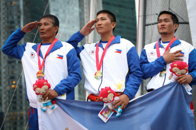 Coach Ridgely Allan Balladares together with teammates Rommel Chavez and Richly Magsanay, won the Philippines its first sailing SEA Games gold in a decade. Photo by Singapore SEA Games Organising Committee/Action Images via Reuters