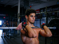 Athletic young man at the gym lifting weights headshot by Seeworthyfilms.