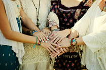 four boho style women from behind outdoo