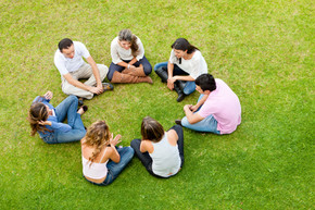 Group of friends sitting down in a circl