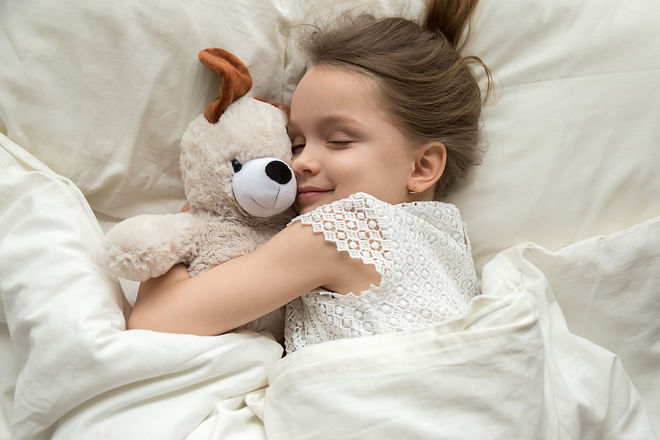 Cute little kid girl hugging teddy bear