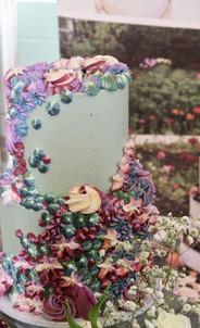 Piped sage green wedding cake