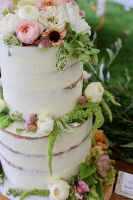 Semi-naked wedding cake with seasonal edible flowers