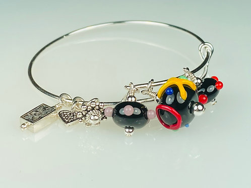 B067 A & A Bracelet Opaque Round Black Bead w/Colorful Scribbles