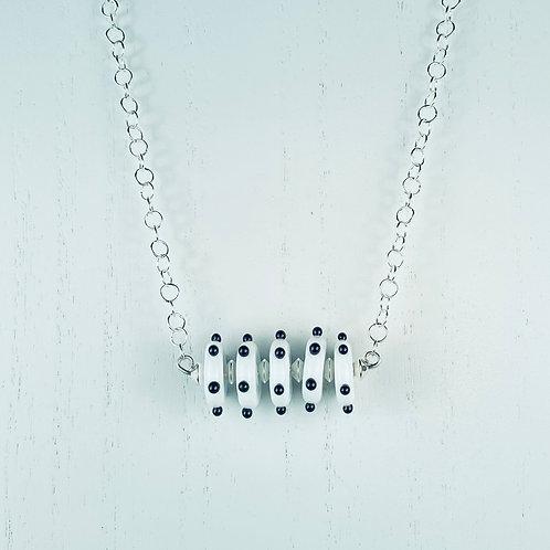 N070 Bar Necklace White Opaque Discs w/Black Dots