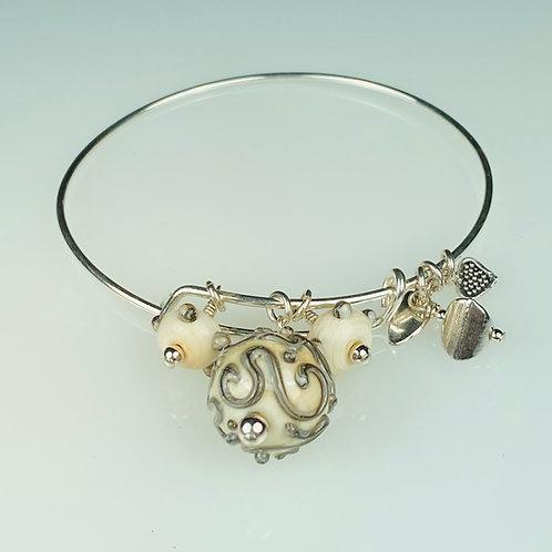 B069 A & A Bracelet Ivory Round Bead w/Silvered Ivory Trim