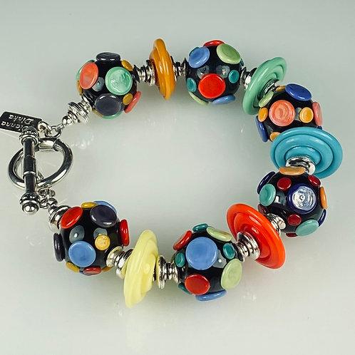 B097 Big Dot Bracelet Black Opaque Beads w/Multicolor Pressed Dot Trim