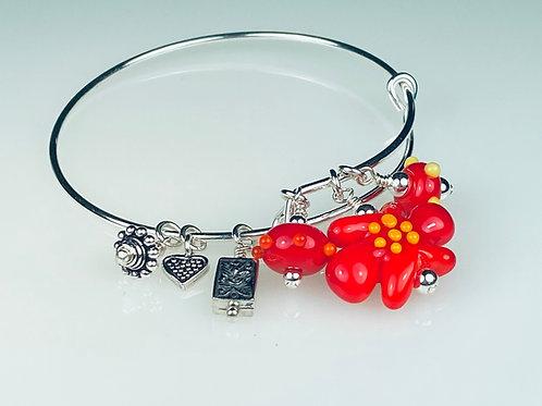 B051 A & A Bracelet Opaque Red Flower Bead w/Orange Trim
