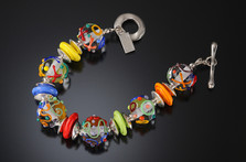 B506 Clear Round Beads w/Multi-Color Scribbles Bracelet