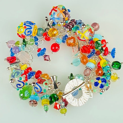 B010 Cha-Cha Bracelet Clear Round Beads w/Colorful Scribbles