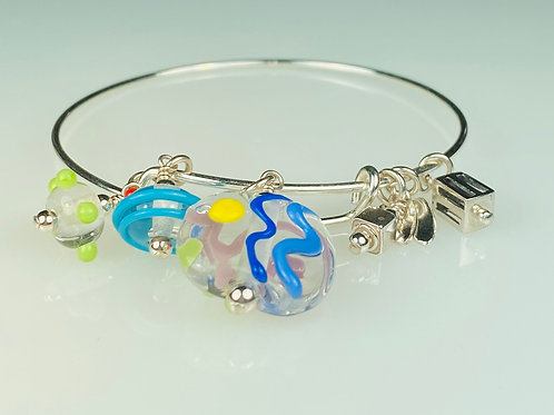 B055 A & A Bracelet Clear Round Beads w/Colorful Scribble & Dot Trim