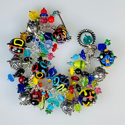 B021 Cha-Cha Bracelet Opaque Black Round Beads w/Multicolor Scribbles
