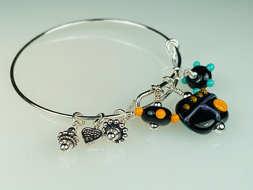 B071 A & A Bracelet Opaque Black Flat Bead w/Colorful Scribbles