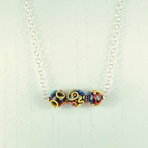 N065 Bar Necklace Opaque Black Round Beads w/Multicolor Scribbles