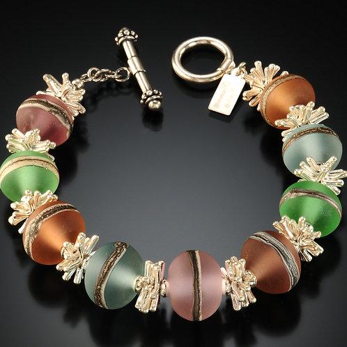 B040 Transparent Bracelet Etched Round Beads Topaz/Lt Blue/Green/Pink