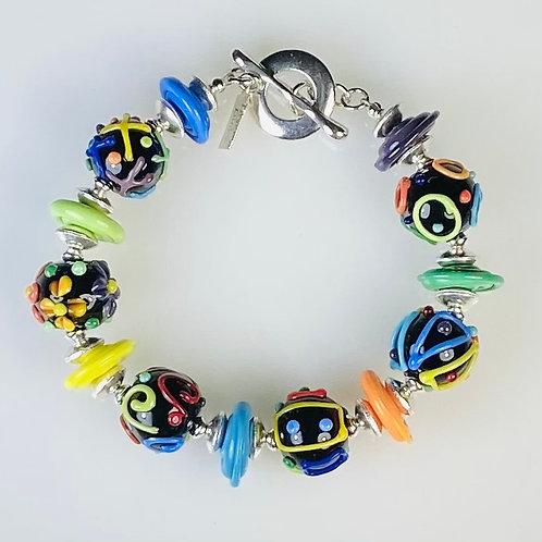 B112 Scribble Bracelet Black Opaque Round Beads w/Multicolor Scribbles