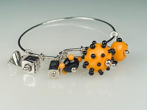 B056 A & A Bracelet Opaque Orange Round Beads w/Black Dot Trim
