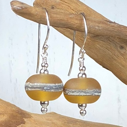 E094 Etched Round Bead Earrings w/Silvered Ivory Trim - Golden