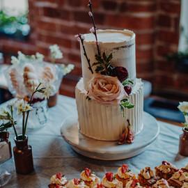 2 tier wedding cake and dessert table
