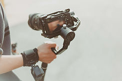 person-holding-black-dslr-camera-1051544