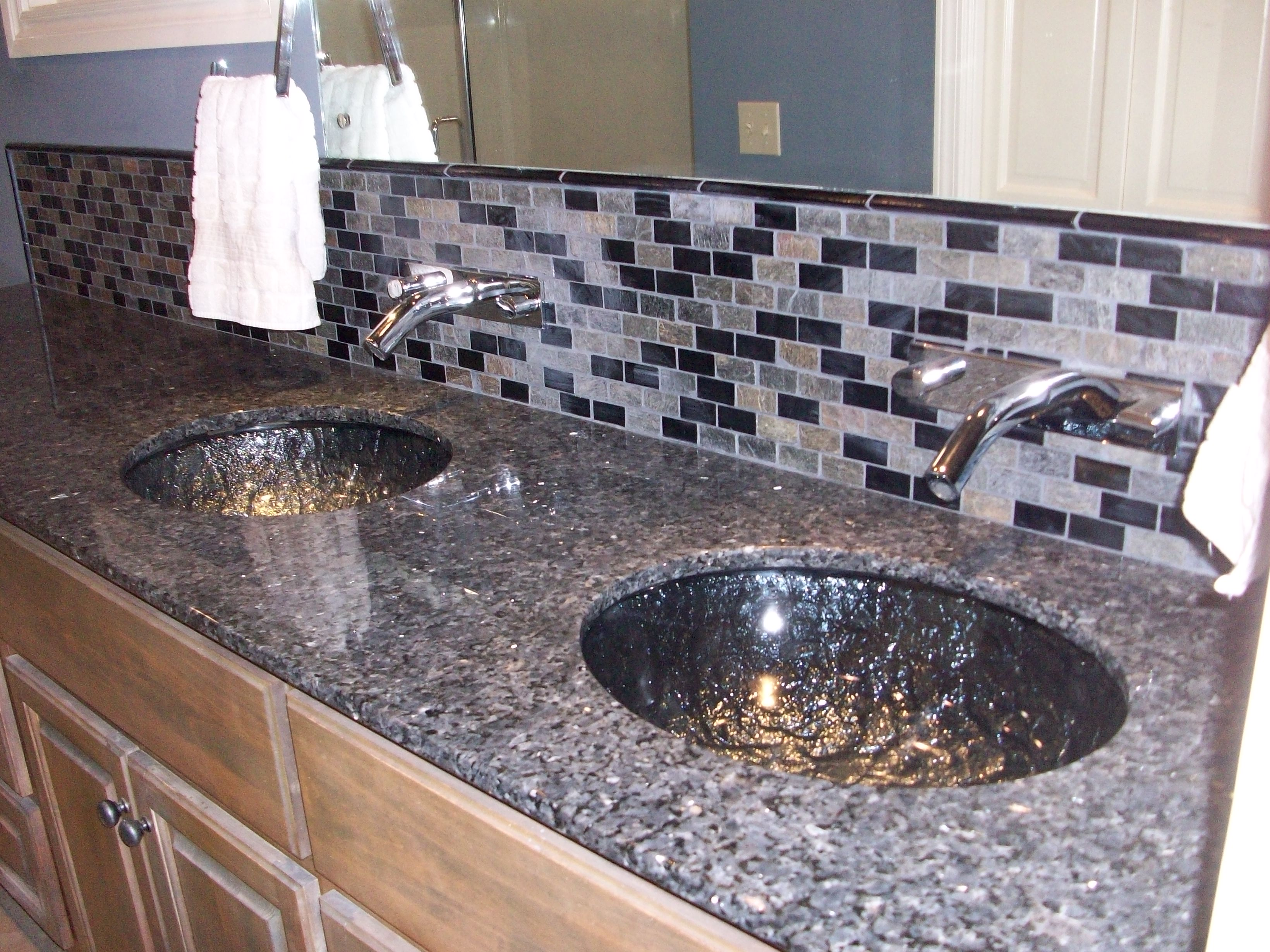 glass sink.  wall mounted faucets