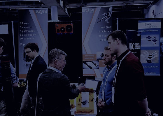 Bota Systems' Co-Founders offering force-sensing support to a customer at a trade show