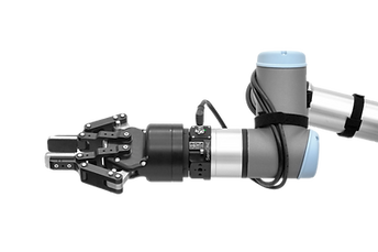 The SesnONE 6 axis force torque sensor attached to a Universal Robot that has a gripper attached for its end of arm tooling