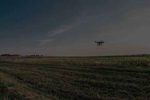 Drone flying with a clear sky in the background