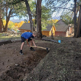 Harper hard at work landscaping for the clubhouse