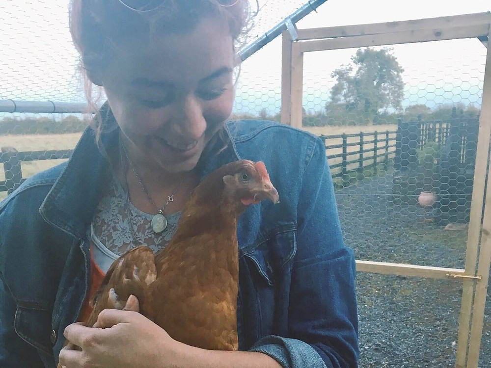 Catherine holding a rescued chicken