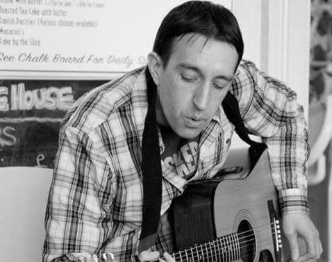 Simon vegan musician on guitar