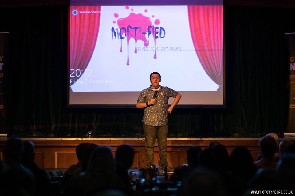 Matt performing at comedy evening