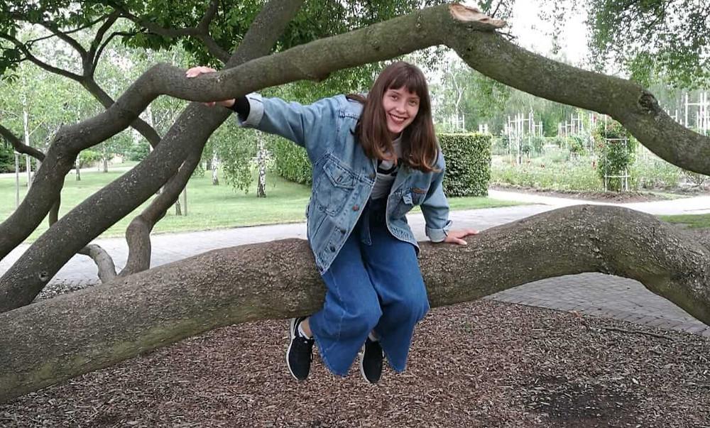 Maja sat on tree branch