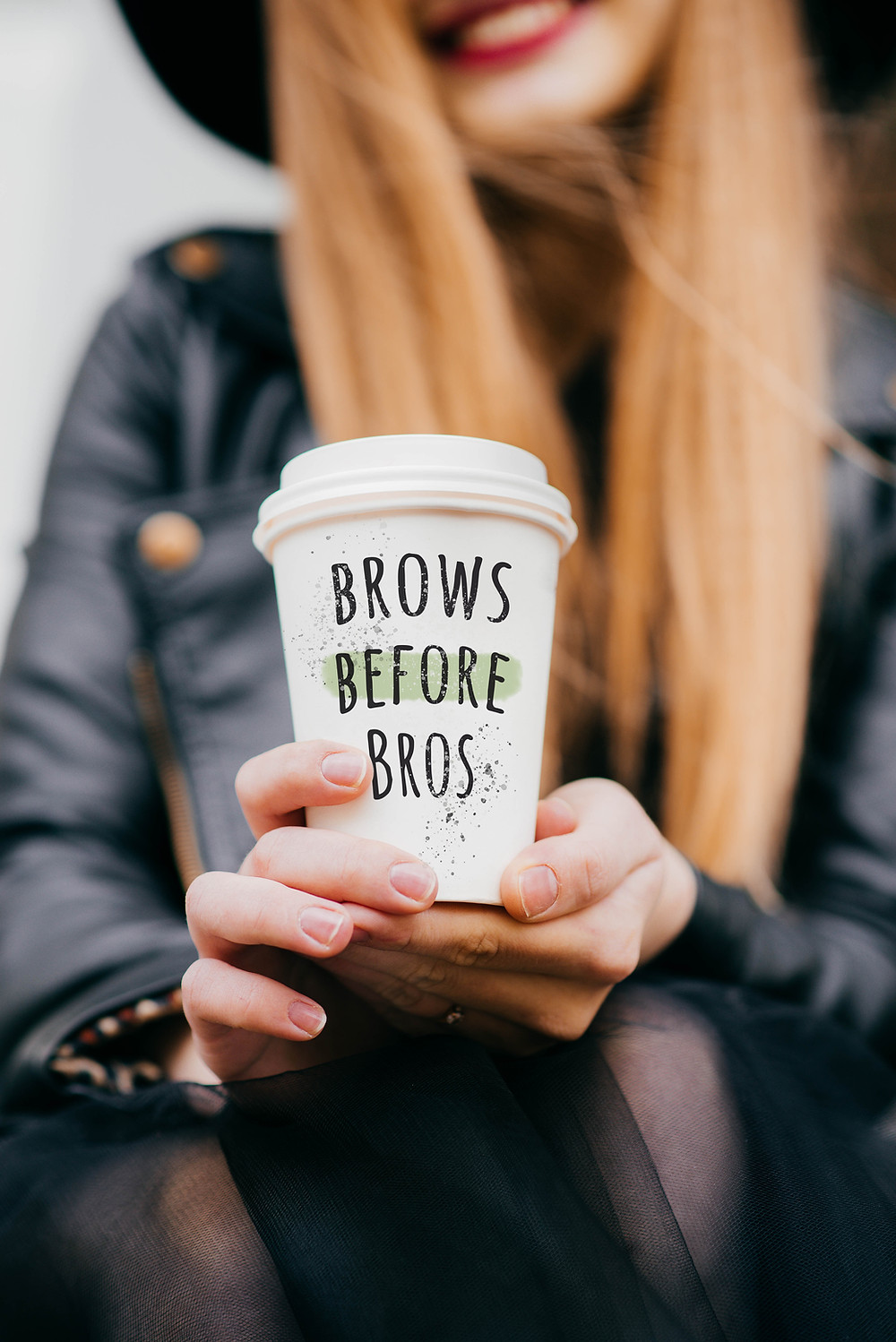 "Woman holding coffee cup saying, ""Brows Before Bros"""