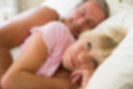 awake couple-lying-in-bed-together_HFLrK