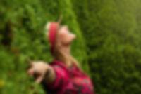 smiling lady in grass beautiful-bush-cas