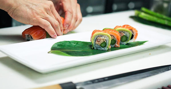 Sushi being hand rolled
